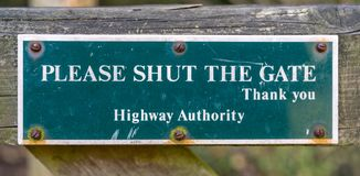 Please Shut The Gate sign, The Cotswolds, Gloucestershire, England royalty free stock photography