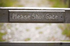 Please Shut Gate Sign Stock Image
