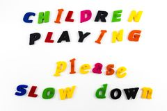 Children playing message slow down Royalty Free Stock Image