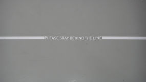 Please stay behind the line Royalty Free Stock Image