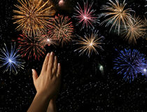 Please stop it I want to sleep. Clasped hands begging for the end of a fireworks show Stock Images