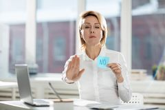 Please stop it. Serious businesswoman stopping someone by gesture and negation sticker Stock Image