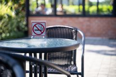 please Stop smoking concept No smoking sign in the coffee shop g stock image