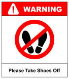 Please take shoes off. Do not step here please sign vector illustration. Red prohibition circle with silhouette of feet Royalty Free Stock Image
