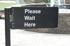 Please Wait Here Stock Images