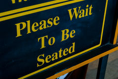 Please Wait To Be Seated Stock Image