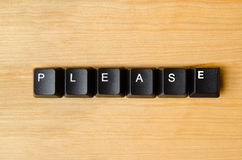 Please word. With keyboard buttons Stock Photography