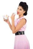 Pleased black hair model eating candies Stock Image