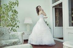 Pleased bride posing in ancient interior Stock Image