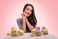 Pleased brunette with bakery Stock Photo