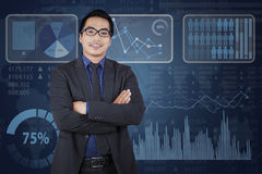 Pleased businessman and business chart Royalty Free Stock Images