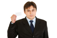 Pleased businessman holding blank business card Royalty Free Stock Photos