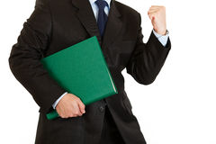 Pleased businessman holding folder. Close-up. Royalty Free Stock Photo