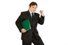 Pleased businessman holding folder with documents Stock Photos
