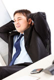 Pleased businessman relaxing on office armchair Stock Photography