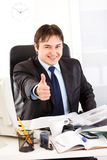 Pleased businessman showing thumbs up gesture Royalty Free Stock Photo
