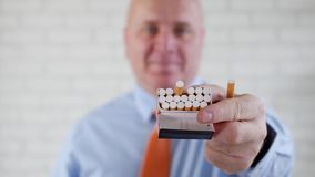 Pleased Businessman Smile Offering a Cigarette from Pack to a Smoker Person stock video footage