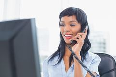 Pleased businesswoman answering the telephone Stock Images
