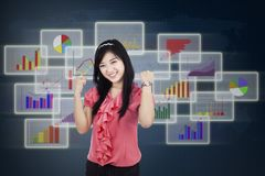 Pleased businesswoman giving thumbs up 2 Royalty Free Stock Photos