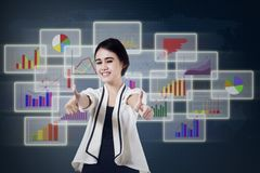Pleased businesswoman giving thumbs up 1 Royalty Free Stock Image