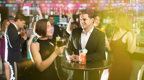 Pleased colleagues dancing on corporate party. With alcohol in hands Stock Photography