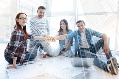Pleased colleagues keeping hands together Stock Photo