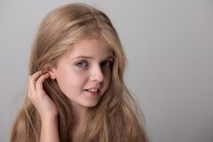 Pleased cute child is expressing curiosity stock photo