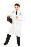 Pleased doctor with clipboard happy dancing Royalty Free Stock Photos
