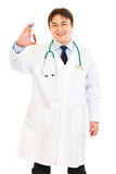 Pleased doctor holding blood sample in hand Royalty Free Stock Photography