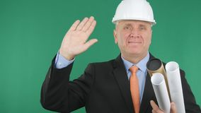 Pleased Engineer Smile and Make a Salute Hand Gestures royalty free stock images