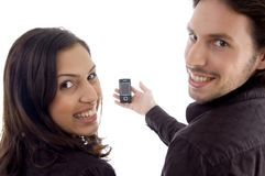 Pleased friends showing cell phone Royalty Free Stock Photo