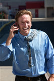 Pleased, good-looking guy talks on cell phone. Royalty Free Stock Image