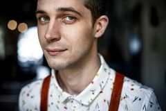 Pleased handsome young man, front view portrait close-up stock photography