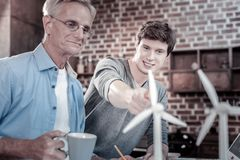 Pleased male engineers making breakthrough royalty free stock images