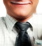 Pleased man with glass of dairy product Royalty Free Stock Photos