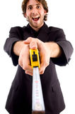 Pleased man showing measuring tape. With white background Stock Images