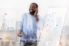 Pleased man talking on the telephone Stock Images