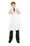 Pleased medical doctor showing thumbs up gesture stock images