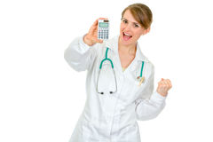 Pleased medical female doctor holding calculator Stock Photography