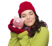 Pleased Mixed Race Woman Hugging Piggybank Isolated on White Stock Photo