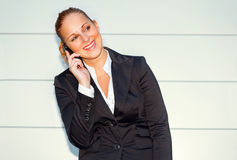Pleased modern business woman talking on mobile Royalty Free Stock Photos