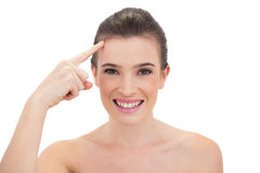 Pleased natural brown haired model touching her brow Stock Photography