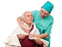 Pleased senior man helped by a nurse Stock Photography