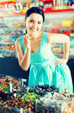 Pleased female posing in the store with lolly Stock Image
