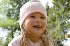 A pleased smile upon one's face. The laughing girl Royalty Free Stock Photography