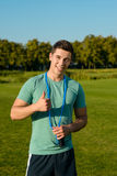 Pleased sportsman showing thumb up. Royalty Free Stock Images