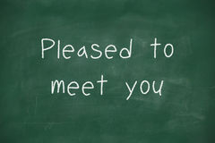 Pleased to meet you handwritten on blackboard Stock Photos