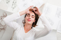 Pleased woman napping among her pictures top view Royalty Free Stock Images
