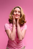 Pleased woman on pink Royalty Free Stock Images