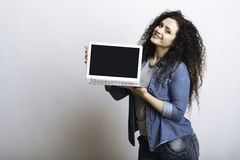 Pleased woman representing new device. royalty free stock images
